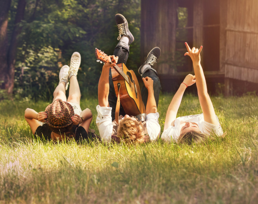 english phrases mate friends lying on the grass with a guitar