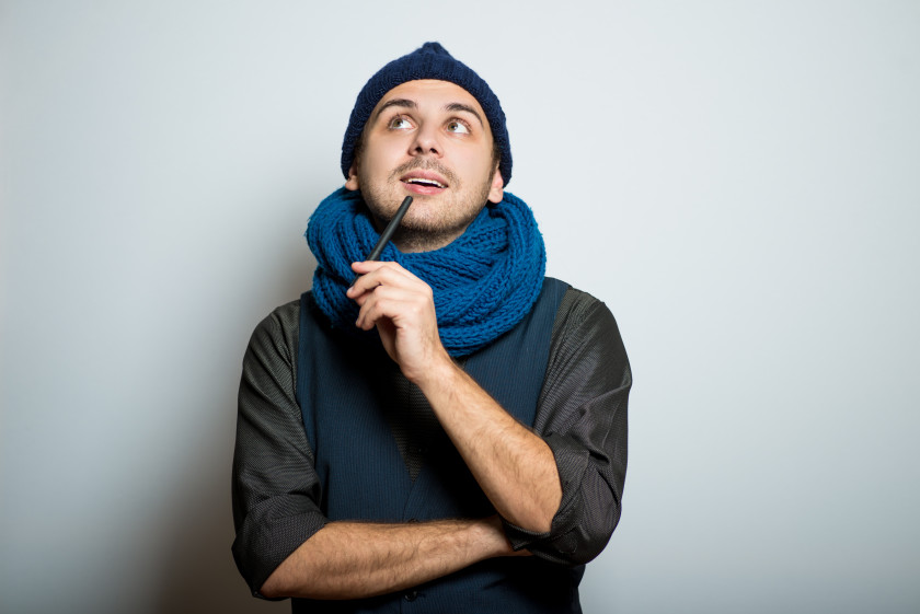 english phrases rings a bell young guy in hat and scarf remembers something
